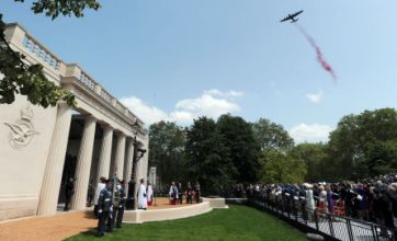 Memorial to Bomber Command opens with a Lancaster dropping poppies