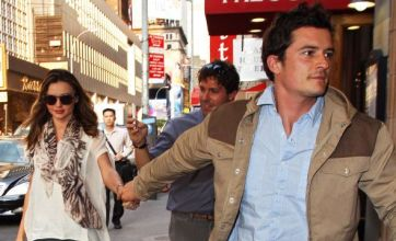 Orlando Bloom rushes Miranda Kerr away from excited fan on date night