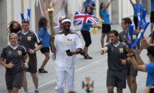 Phillips Idowu was full of emotion after carrying the Olympic torch (PA)