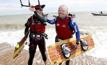 Sir Richard Branson becomes oldest person to kite-surf English Channel