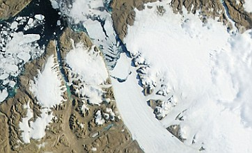 Giant iceberg breaks off glacier and sparks global warming fears