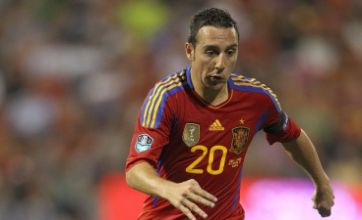 Malaga deny Santi Cazorla is set to join Arsenal to boost coffers