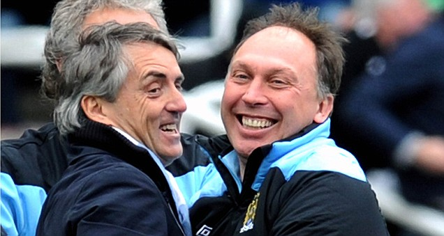 Manchester City boss Roberto Mancini with David Platt