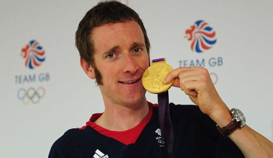 Bradley Wiggins poses with gold medal
