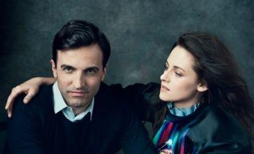Kristen Stewart cuddles up to handsome designer in Vogue shoot