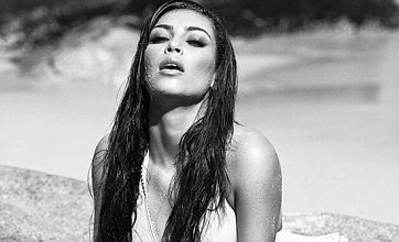 Kim Kardashian posts bikini pics as Kourtney predicts Kanye West babies