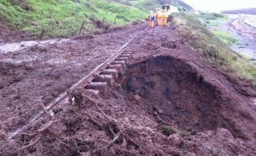Train derails in Cumbria after flash floods follow heavy rain