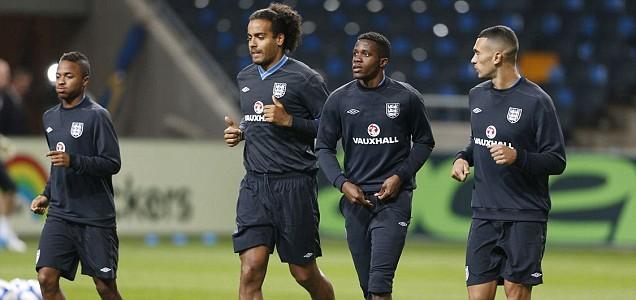 England's Tom Huddlestone (2nd L), Wilfried Zaha (2nd R), Raheem Sterling (L) and Steven Caulker
