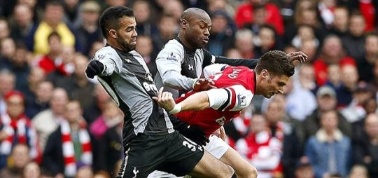 Olivier Giroud (R) of Arsenal vies for the ball with Sandro (L) and William Gallas (C) of Tottenham