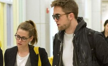 Robert Pattinson and Kristen Stewart head back to US after family trip to UK