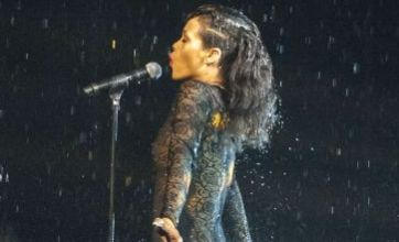 Rihanna in need of her Umbrella after wet and wild X Factor performance