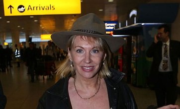 Defiant Nadine Dorries returns to UK to face I'm A Celebrity fallout