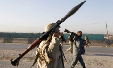 Taliban suicide bombers hit US Afghan air base and kill five civilians