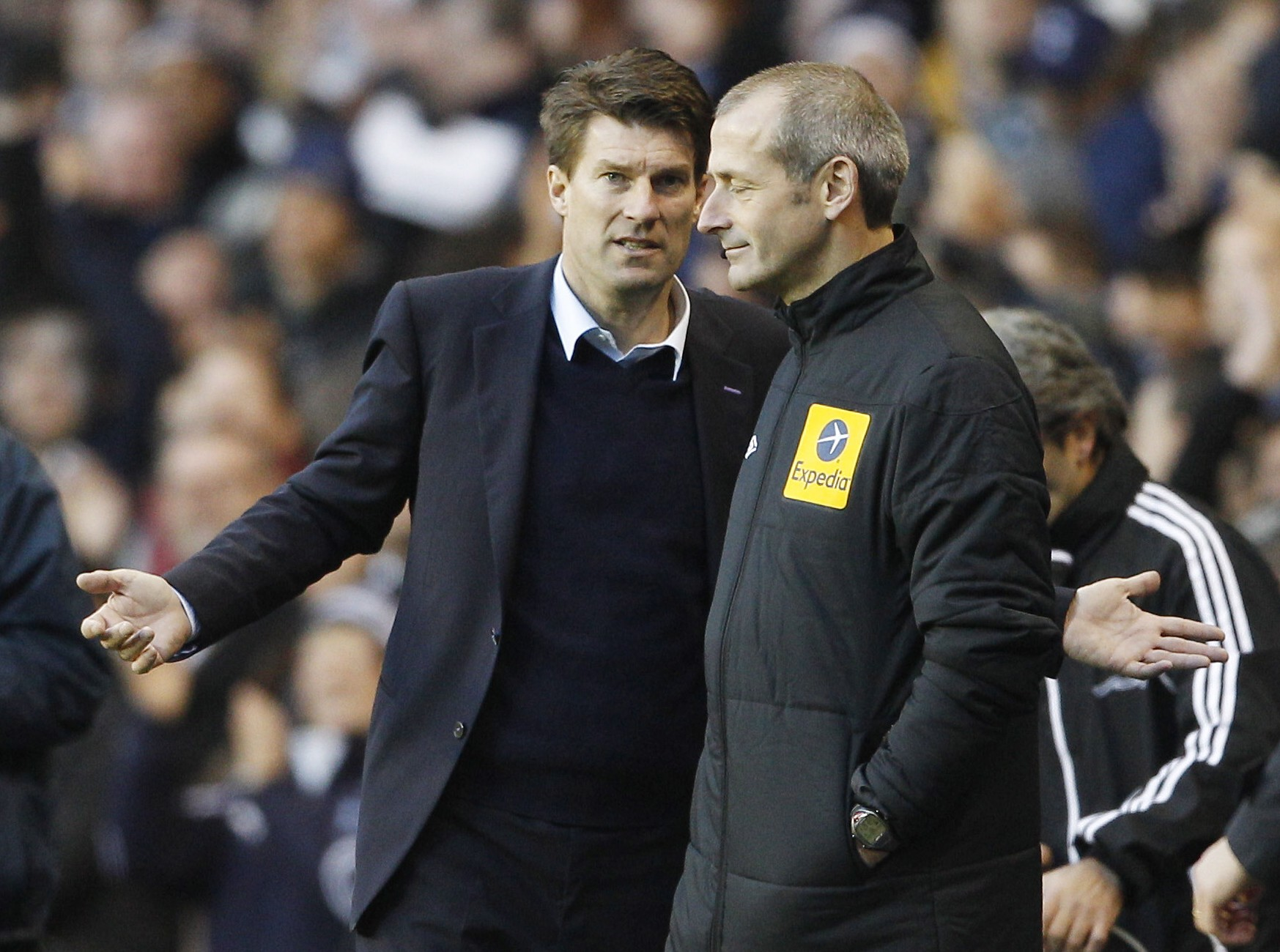 Michael Laudrup (left) was unimpressed with the performance of referee Mike Dean as his Swansea side lost 1-0 at Spurs (Picture: Reuters/Action Images)