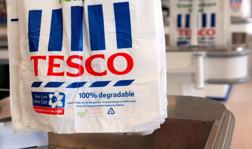 Tesco vows to back British farmers after horse meat scandal