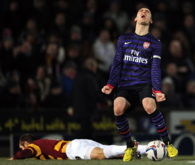 Thomas Vermaelen of Arsenal shows his anguish at being called for a foul against James Hanson of Bradford during the Capital One Cup match between Arsenal and Bradford City