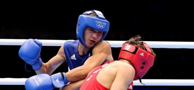 Andrew Selby of Great Britain (L) in action with Ilyas Suleimeno