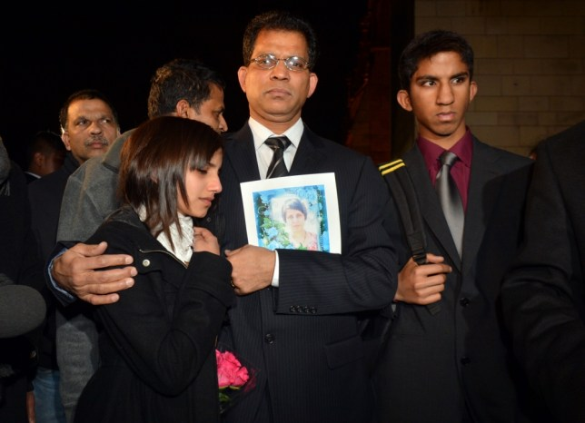 Jacintha Saldanha's widower Benedict Barboza with her children outside Parliament (Picture: PA)