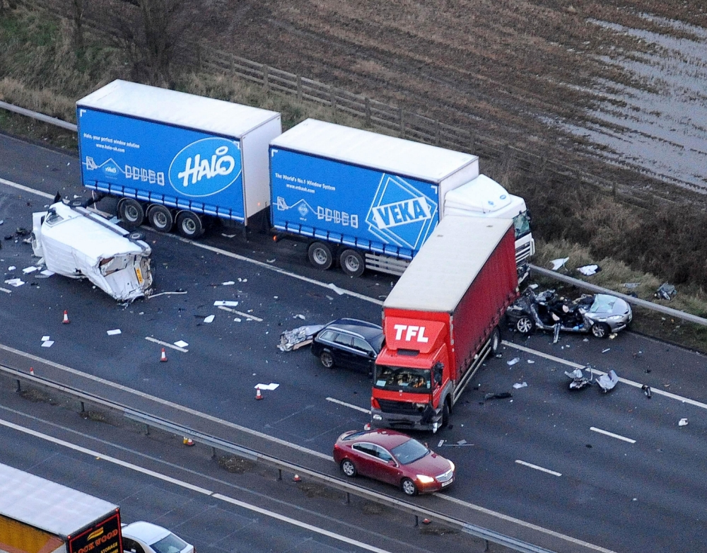 Wreckage: Debris from HGVs, vans and cars lies across the the M6 in Cheshire after a collisioninvolving nine vehicles (Picture: Caters)