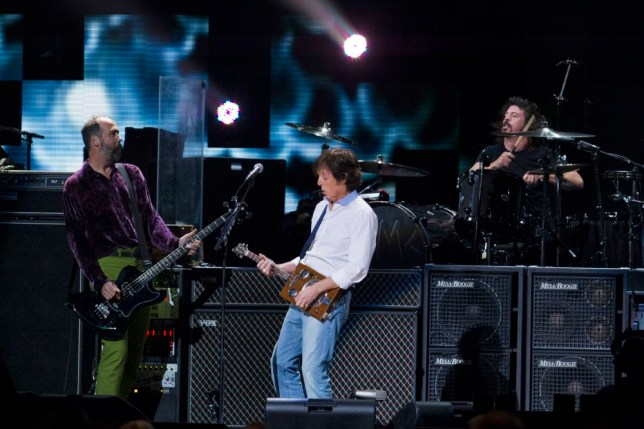 McCartney performs with Krist Novoselic (L) and Dave Grohl