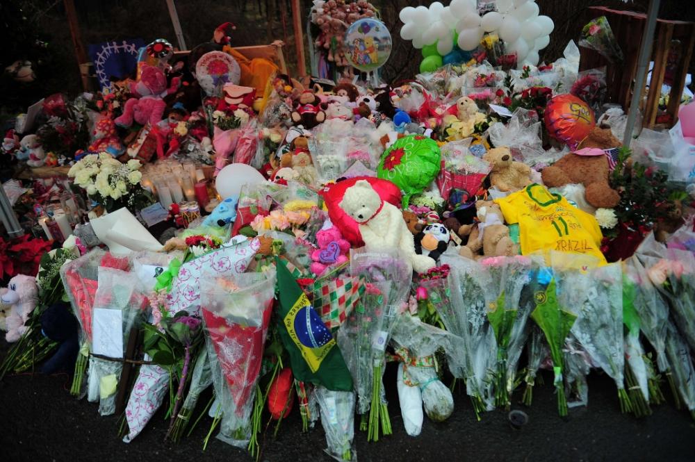 First funerals held for Newtown school massacre victims