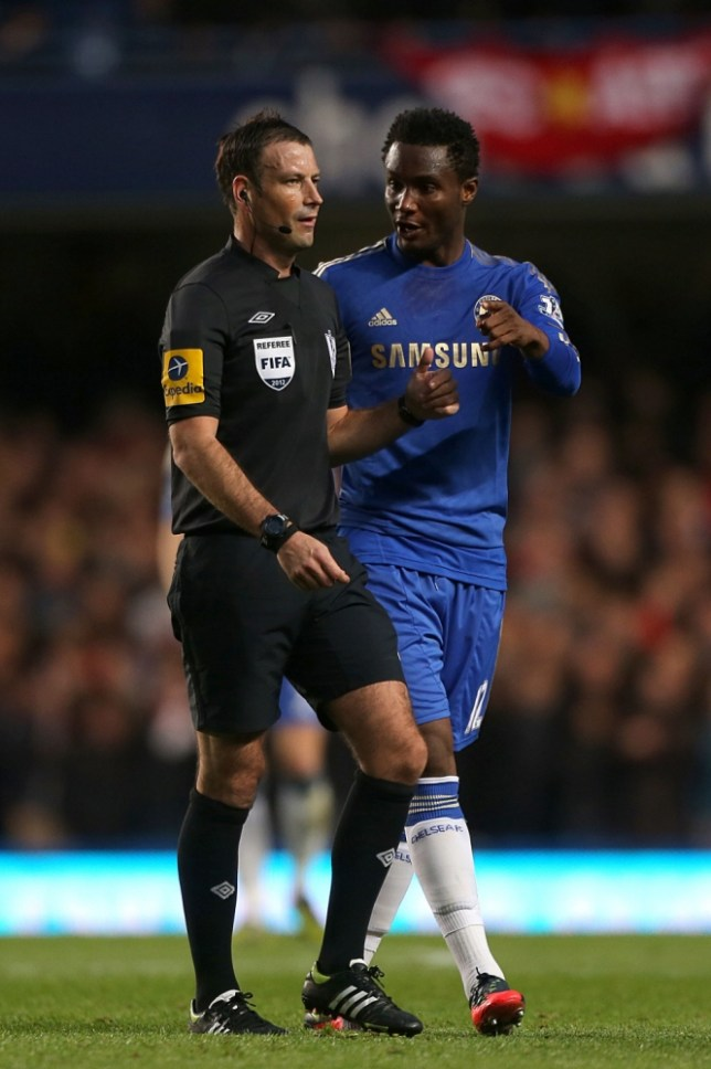 John Obi Mikel (right) believed he had been racially abused by referee Mark Clattenburg (left) (Picture: PA)