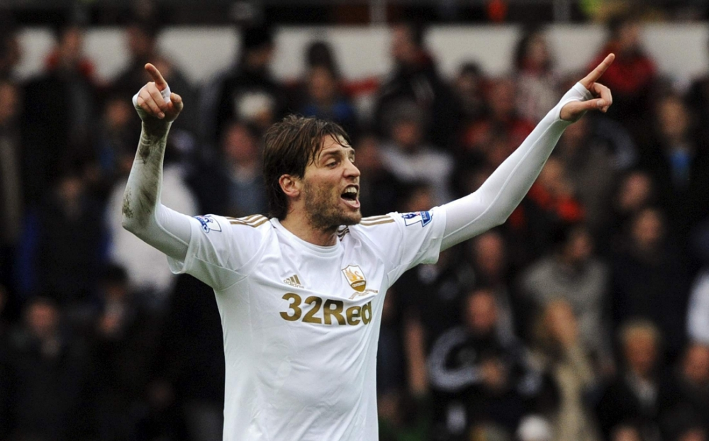 Swansea hold Manchester United as Michu cancels out Patrice Evra strike