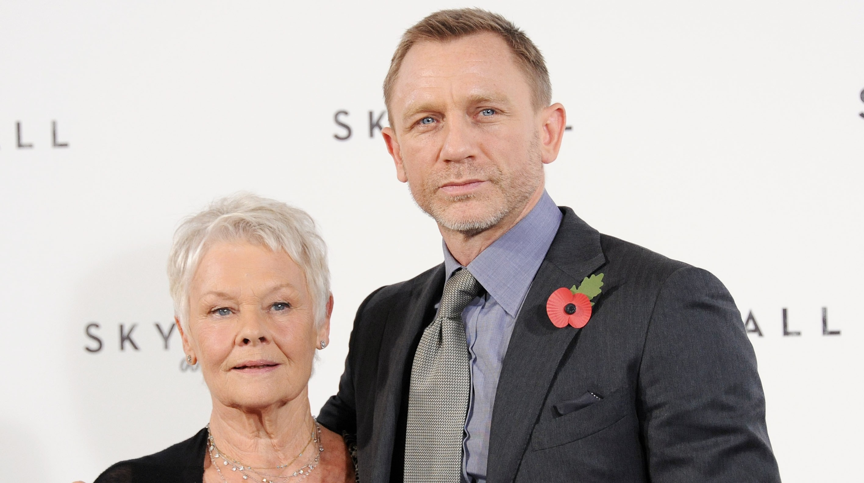 Judi Dench poses with Skyfall co-star Daniel Craig (Picture: Getty)