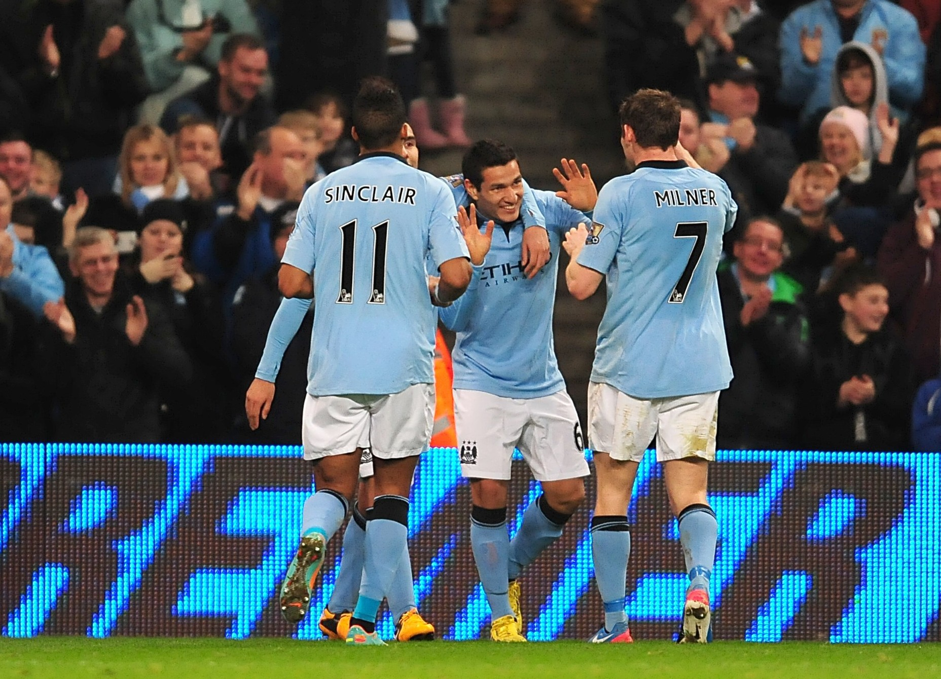 Marcos Lopes (centre) was a goalscoring substitute in Manchester City's win over Watford (Picture: PA)