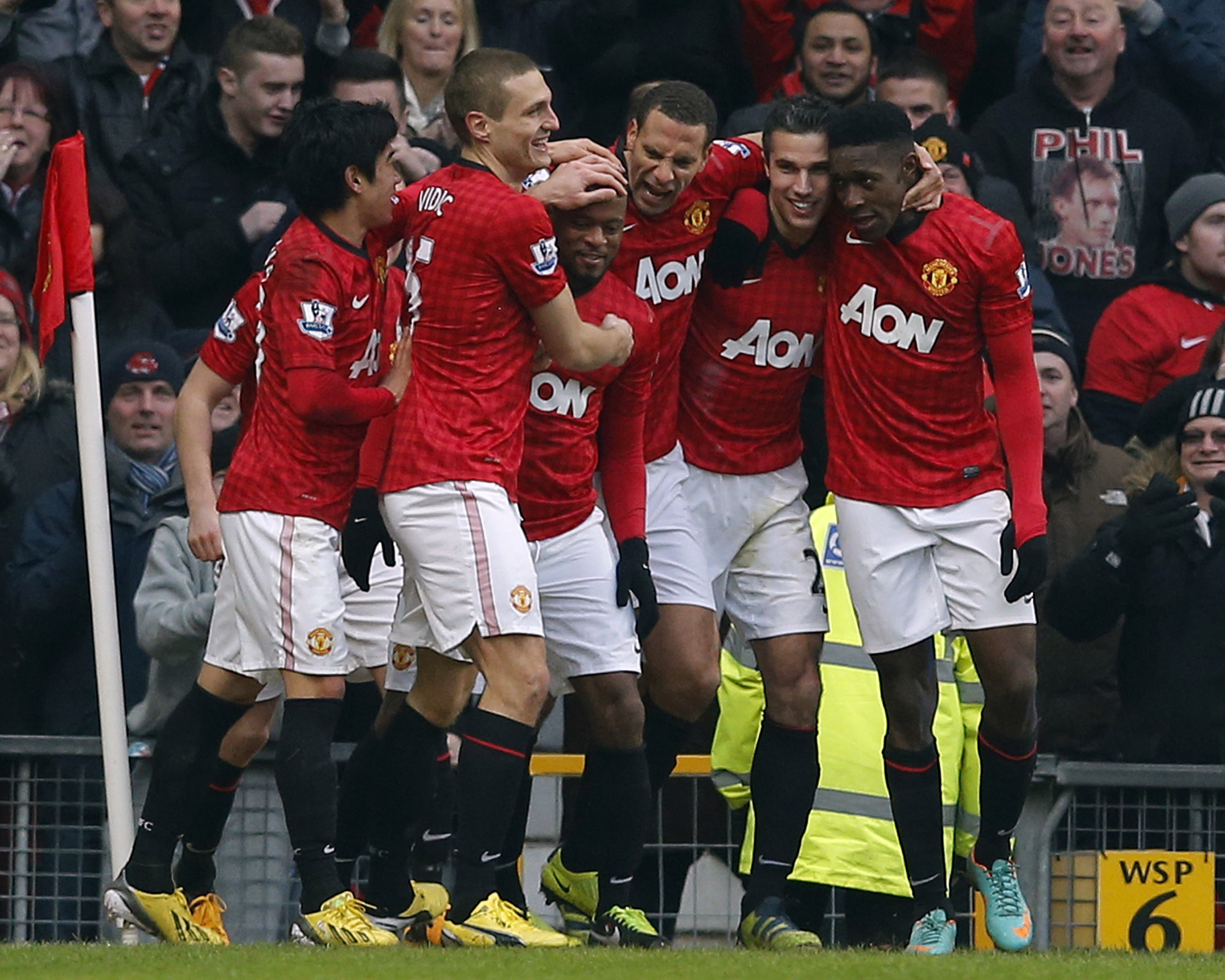 Manchester United's Patrice Evra celebrates his goal against Liverpool with team mates (Reuters)