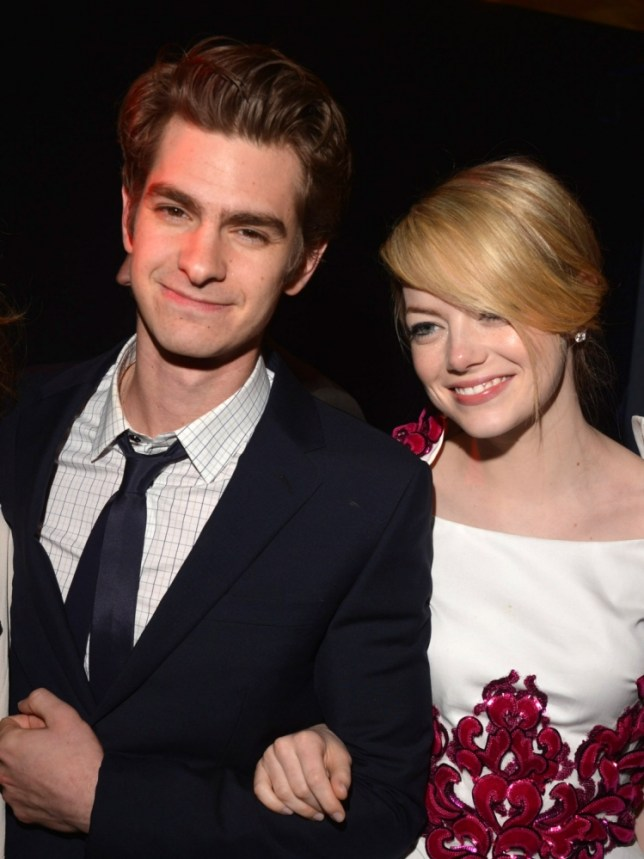 Andrew Garfield and girlfriend Emma Stone took to the seas for a surf lesson in Hawaii on Sunday (Photo by Lester Cohen/WireImage)