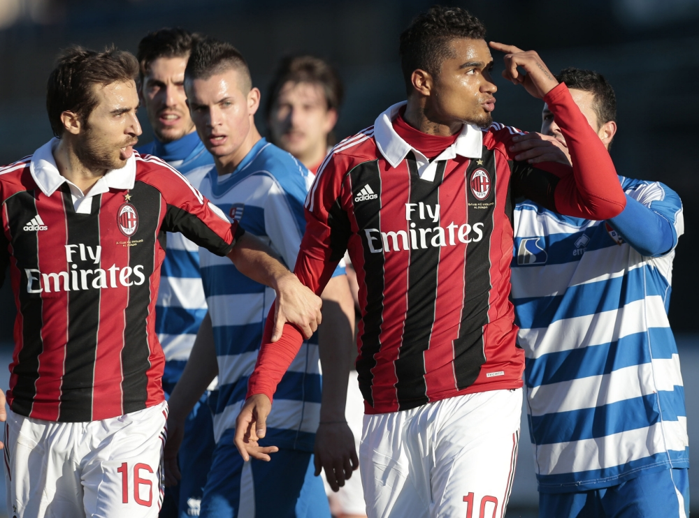 Kevin-Prince Boateng (right) and his AC Milan team-mates took a firm stance in their friendly with Pro Patria (Picture: AP)