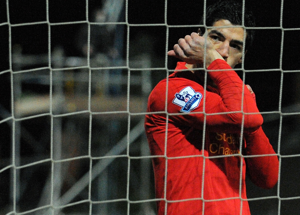 Luis Suarez sealed the win for Liverpool despite an alleged handball (Picture: AFP)