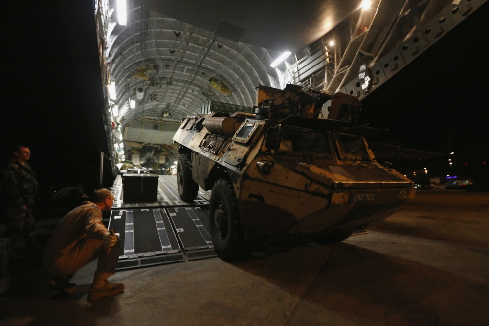 RAF C-17 plane arrives in Mali as France pledges more troops to fight Islamist insurgency