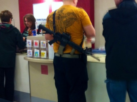 Utah man goes shopping with rifle on his back