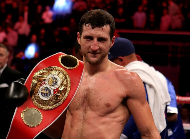 Carl Froch celebrates beating Yusaf Mack during the IBF World Su