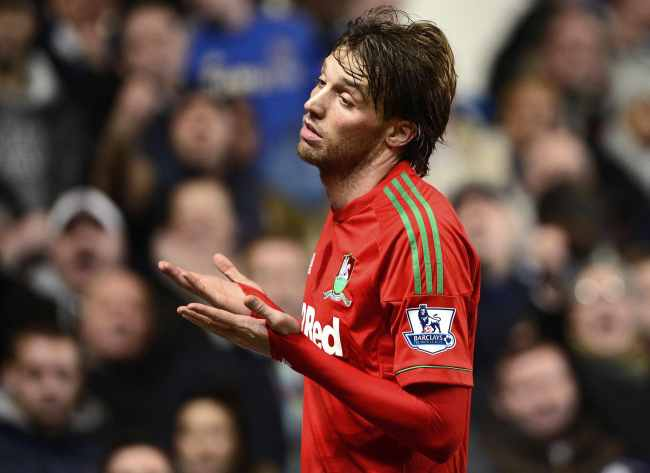 Swansea City's Michu scores against Chelsea