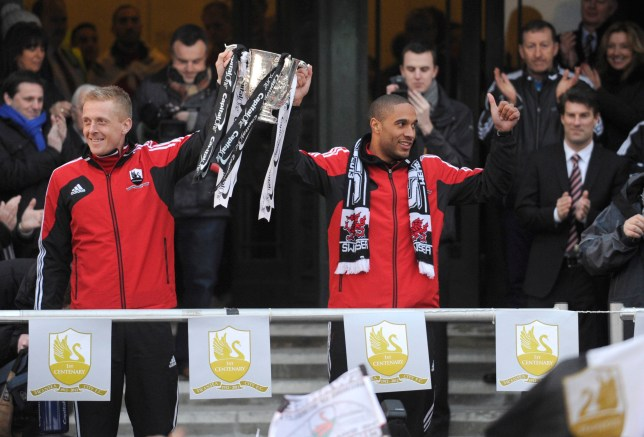Swansea City's Gary Monk and Ashley Williams hold the trophy at the Guildhall to celebrate their English League Cup final soccer match win, in Swansea