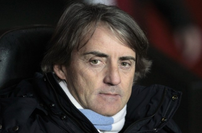 Uncertain times: Mancini could be set for the axe (Picture: AP)