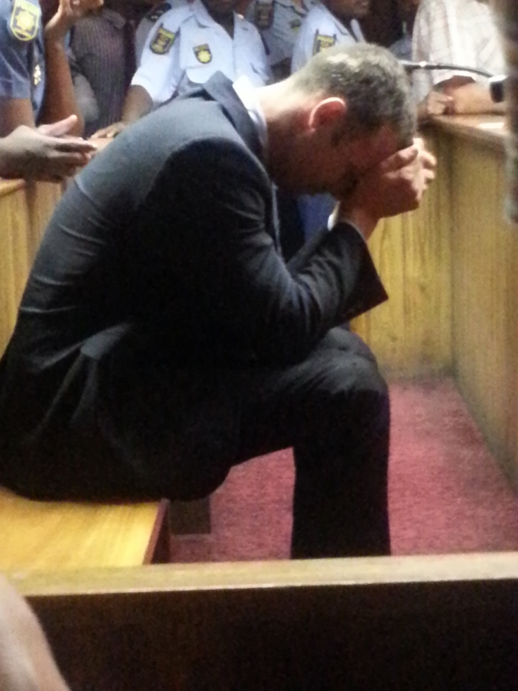 Oscar Pistorius denies murdering girlfriend after tearful court appearance