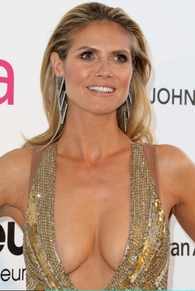 Heidi Klum flashes daring cleavage in low-cut dress at Elton John's post-Oscars party