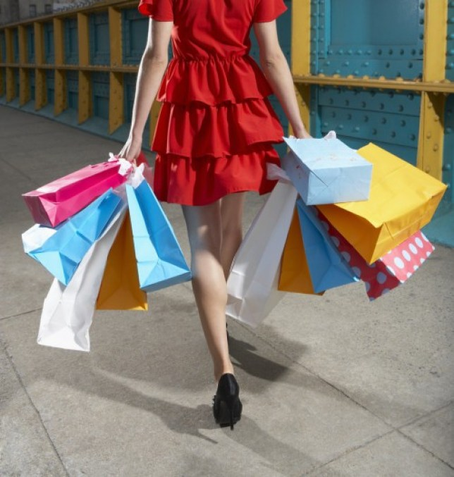 Young woman walking with shopping bags.