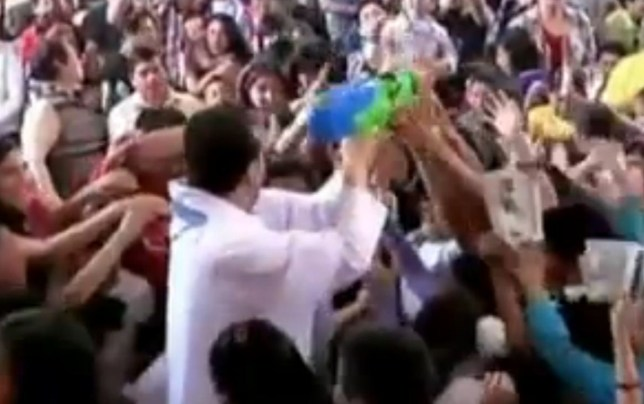 Mexican priest, water gun
