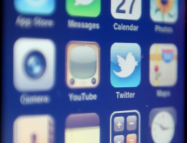 EMBARGOED TO 0001 THURSDAY MARCH 21 File photo adted 27/12/10 of the logo of social networking website Twitter displayed on the screen of an iPhone smartphone, as a host of celebrities celebrated seven years of Twitter today. PA Wire/Press Association Images