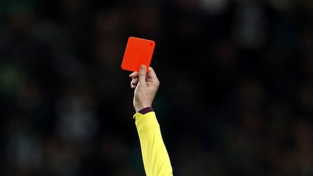 Sporting's Marcos Rojo (L) receives a red card from referee Paulo Batista during their Portuguese Premier League soccer match against Porto at Alvalade stadium in Lisbon March 2, 2013. REUTERS