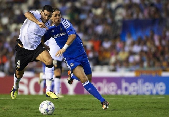 Fernando Torres (R) of Chelsea competes for the ball with Adil Rami of Valencia during the UEFA Champions League Group E match between Valencia CF and Chelsea at Estadio Mestalla on September 28, 2011 in Valencia, Spain.     VALENCIA, SPAIN - SEPTEMBER 28:   (Photo by Manuel Queimadelos Alonso/Getty Images)