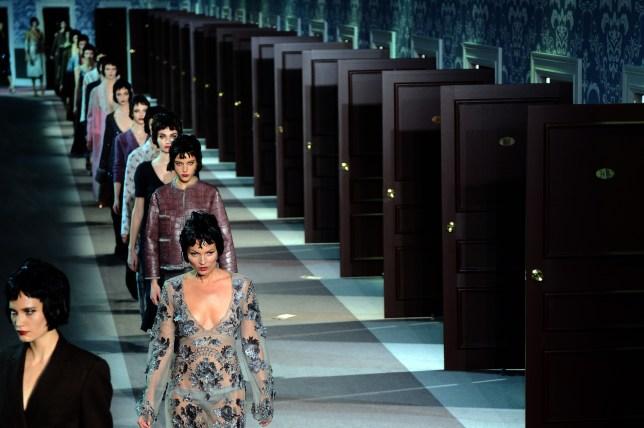 British model Kate Moss (C) presents a c