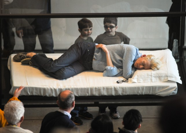 Tilda Swinton sleeps in a glass box as part of The Maybe (Picture: Splash)