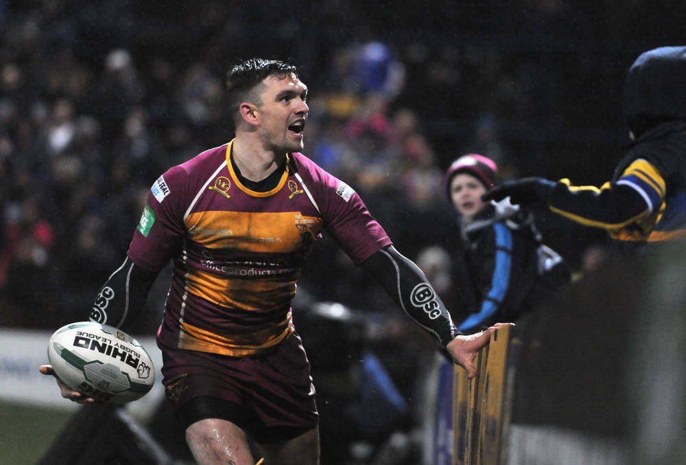 Huddersfield Giants' Danny Brough celebrates after scoring a try during the Super League match at Headingley Carnegie, Leeds. PRESS ASSOCIATION Photo. Picture date: Friday  March 8, 2013. Photo credit should read: Anna Gowthorpe/PA Wire. RESTRICTIONS: Use subject to restrictions. Editorial use only. No commercial use. Call +44 (0)1158 447447 for further information.