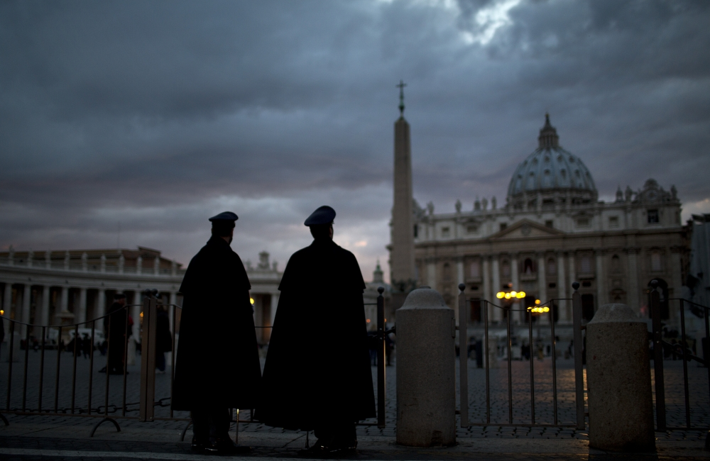 Police officers are seen outside St. Peter's Square, at the Vatican, Monday, March 11, 2013. Cardinals have gathered for their final day of talks before the conclave to elect the next pope amid debate over whether the Catholic Church needs a manager pope to clean up the Vatican's messy bureaucracy or a pastoral pope who can inspire the faithful and make Catholicism relevant again. (AP Photo/Emilio Morenatti)